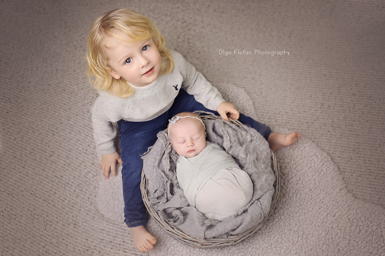 newborn photograph with older sibling taken by Olga Klofac photography Galway