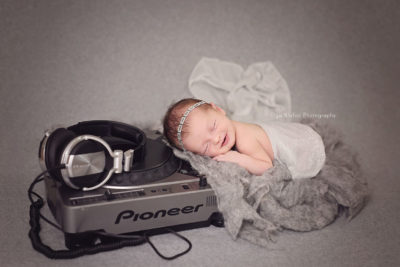 newborn baby girl photographed with DJ equipment