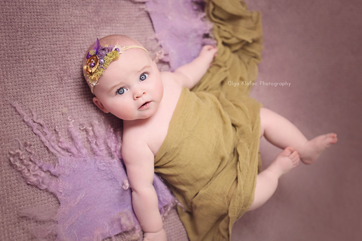 5-month-old baby girl wearing purple and green headband