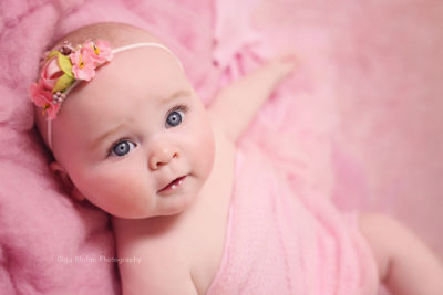 5-month-old baby girl wearing pink headband