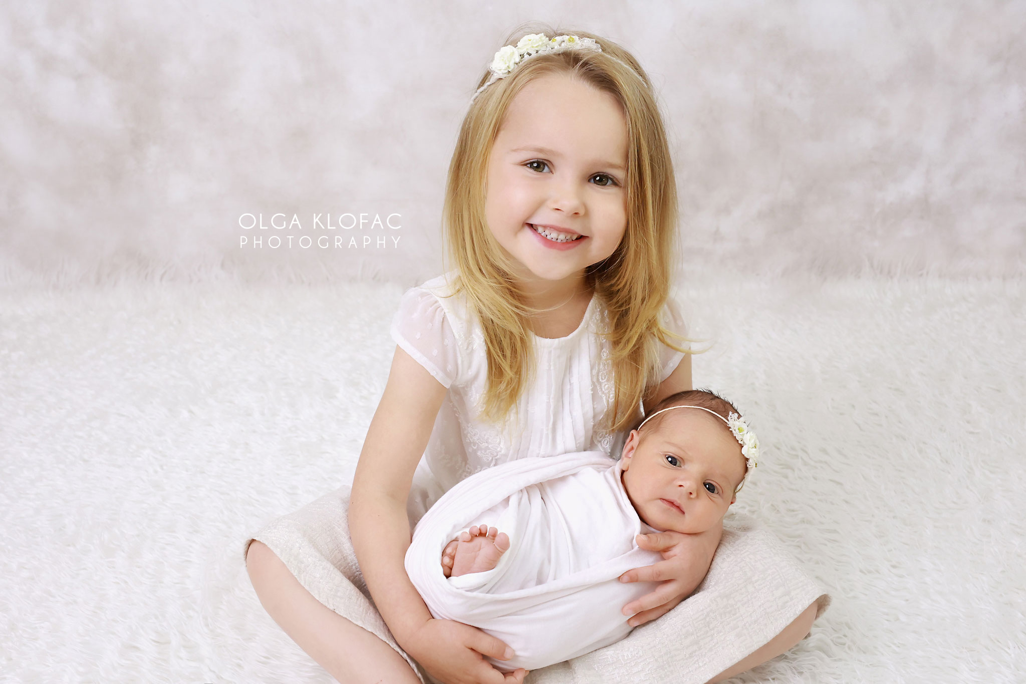 family photo of a girl with her newborn baby sister by prfessional baby photographer Mayo Sligo Galway