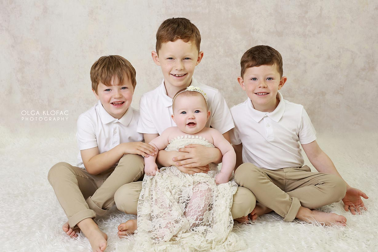professional photograph of 6 month old baby girl with her three brothers by Olga Klofac Photography Sligo